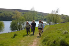 Walkers at Wimbleball reservoir, Exmoor National Park, Somerset